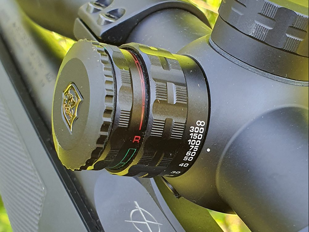Réglage du focus, et illumination du point rouge (ou vert)